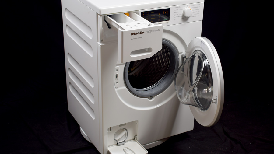 Miele WDB020 washing machine, door and detergent drawer open
